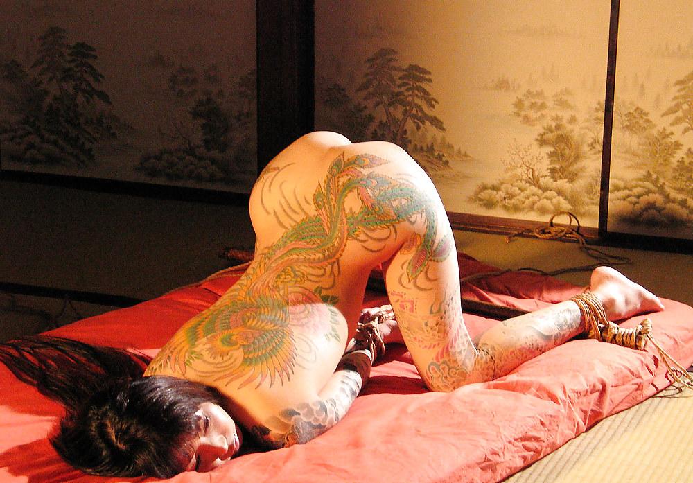 Sexy tattooed woman bondage, nake blond