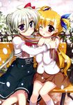 2girls blonde_hair blush einhart_stratos fujima_takuya green_hair hair_ornament heterochromia hug long_hair looking_at_viewer lyrical_nanoha mahou_shoujo_lyrical_nanoha mahou_shoujo_lyrical_nanoha_vivid multiple_girls official_art one_eye_closed open_mouth scarf snow vivio yuri