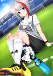 1girl 2018 2018_fifa_world_cup adidas admiral_graf_spee_(azur_lane) arm_support armband azur_lane ball bangs black_shorts blue_eyes blue_sky blush bottle breasts closed_mouth cloud commentary_request day dutch_angle eyebrows_visible_through_hair fingernails german_flag goal grass hand_on_own_knee highres kneehighs large_breasts leng_xiao looking_at_viewer mosaic multicolored_hair on_grass outdoors print_shirt red_hair shirt shoes short_hair short_shorts short_sleeves shorts silver_hair sitting sky sneakers soccer soccer_ball soccer_field soccer_uniform solo sportswear stadium streaked_hair sweat sweatband telstar_18 thighs water_bottle white_legwear white_shirt world_cup yellow_footwear