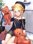 1girl abigail_williams_(fate/grand_order) bangs bare_shoulders beret black_bow black_hat black_shirt black_shorts blonde_hair blue_eyes blush bow bracelet breasts closed_mouth collarbone fate/grand_order fate_(series) forehead hair_bow hat highres holding holding_stuffed_animal indoors jewelry long_hair looking_at_viewer off_shoulder orange_bow parted_bangs plant potted_plant shiguru shirt shorts sitting sleeves_past_fingers sleeves_past_wrists small_breasts solo stuffed_animal stuffed_toy teddy_bear thighs