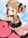 1girl abigail_williams_(fate/grand_order) andrian_gilang bangs bikini black_bow blonde_hair blue_eyes blush bow double_bun fork hair_bow highres long_hair looking_at_viewer mouth_hold orange_bow outdoors parted_bangs polka_dot polka_dot_bow solo sweat swimsuit upper_body